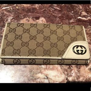 Authentic Gucci leather monogram bifold wallet